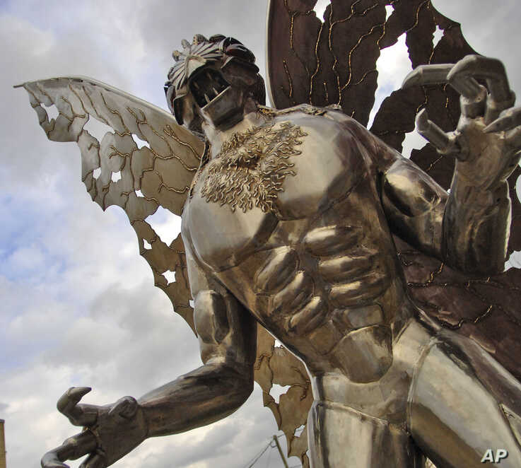 FILE — A Mothman statue looks onto Main Street in Point Pleasant, West Virginia.