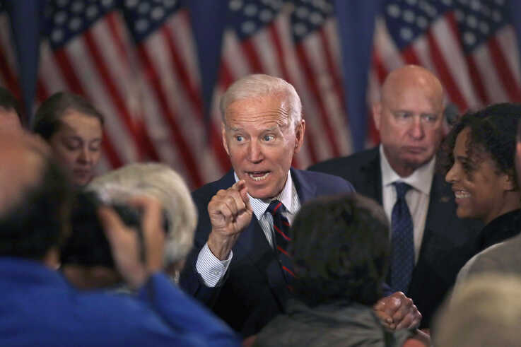 Democratic presidential candidate and former Vice President Joe Biden speaks to people at a campaign event, Wednesday, Oct. 9,…