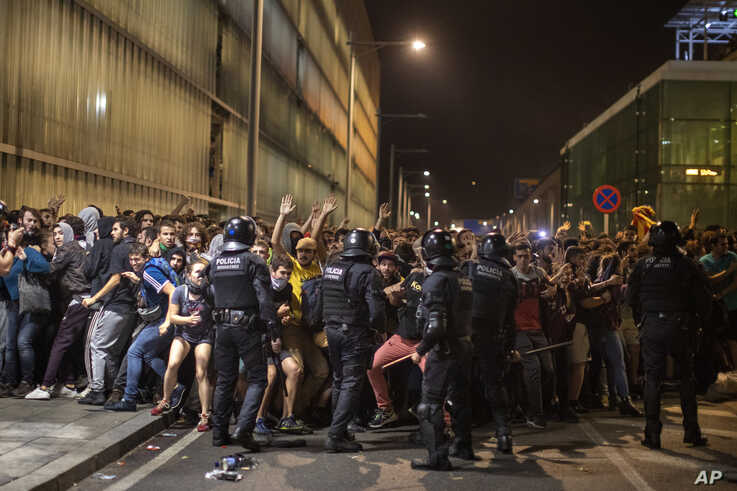 Police charge against demonstrators during clashes outside El Prat airport in Barcelona, Spain, Monday, Oct. 14, 2019. Riot…
