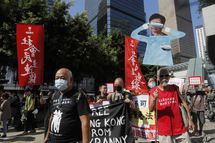 Protesters stage a rally outside Legislative Council as Hong Kong Chief Executive Carrie Lam  delivers her speech in Hong Kong…