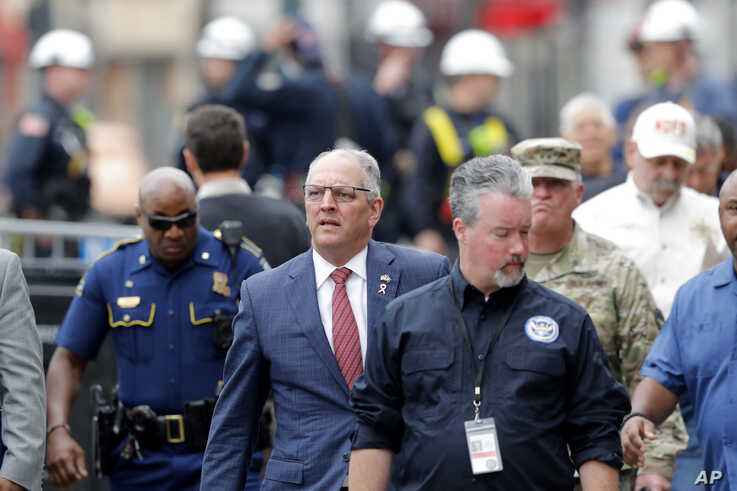 Louisiana Gov. John Bel Edwards tours the scene before addressing reporters near the Hard Rock Hotel, which underwent a partial…