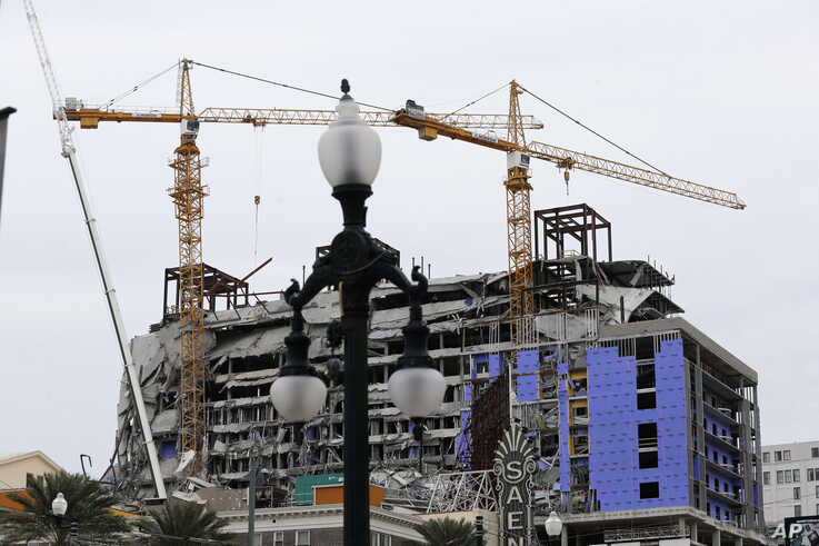 Two unstable cranes loom over the construction of a Hard Rock Hotel, Thursday, Oct. 17, 2019, in New Orleans.  The 18-story…