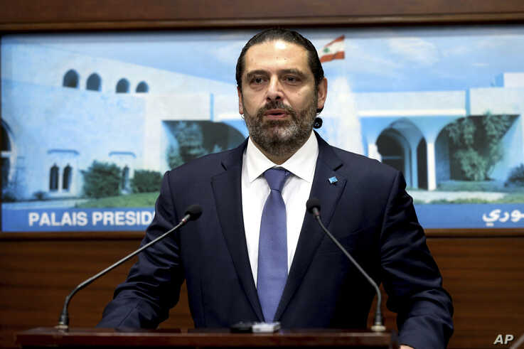 In this photo released by Lebanon's official government photographer Dalati Nohra, Lebanese Prime Minister Saad Hariri, speaks after a cabinet meeting, at the presidential palace, in Baabda, east of Beirut, Lebanon, Oct. 21, 2019.