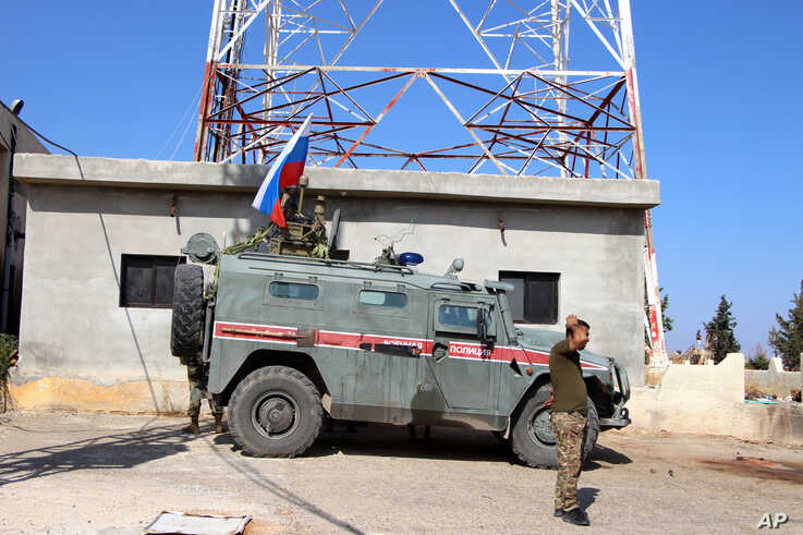 Russian forces armored vehicles patrol the Syrian border in Kobani, Wednesday, Oct. 23, 2019. Russian military police began…