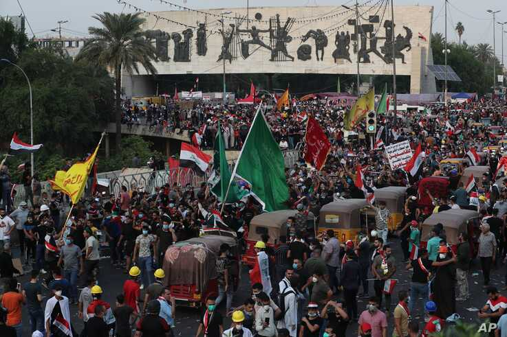 Anti-government protesters gather during a demonstration in Baghdad, Iraq, Tuesday, Oct. 29, 2019. (AP Photo/Khalid Mohammed)