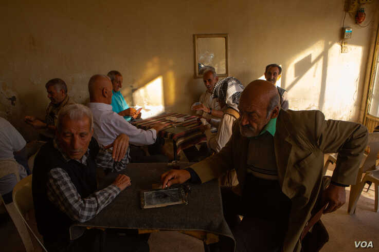 At a tea shop, Turkey Hussain, right, says Kurdish forces cannot win in a fight against Turkey without international support, in Dirik, Syria, Oct. 23, 2019. (Yan Boechat/VOA)