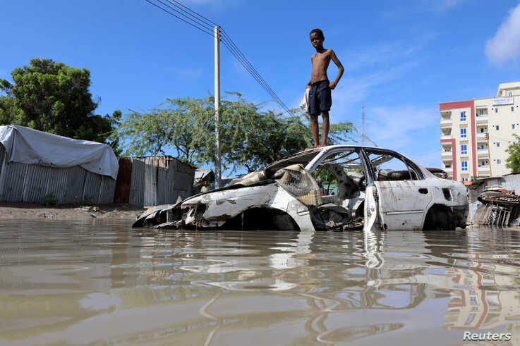A Somali boy stands on a junk vehicle after heavy rain flooded their neighbourhood in Mogadishu, Somalia October 21, 2019…
