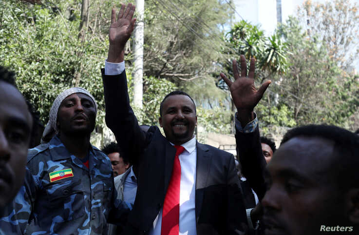 Jawar Mohammed, an Oromo activist and leader of the Oromo protest waves to his supporters outside his house in Addis Ababa,…