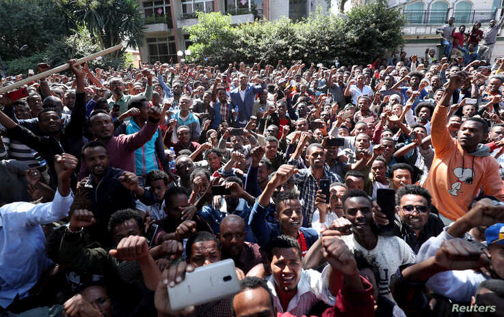 Oromo youth shout slogans outside Jawar Mohammed's house, an Oromo activist and leader of the Oromo protest in Addis Ababa,…