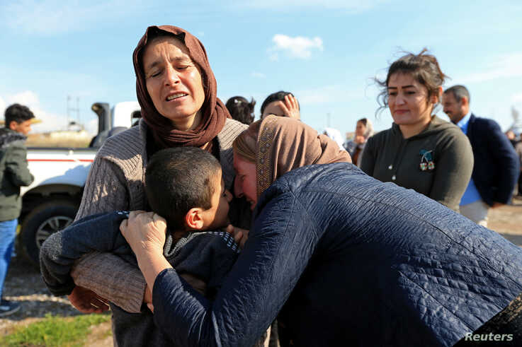Relatives hug a Yazidi survivor boy following his release from Islamic State militants in Syria, in Duhok, Iraq, March 2, 2019…