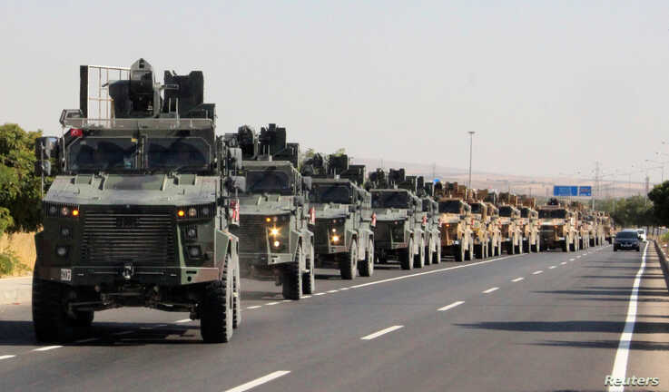 A Turkish miltary convoy is pictured in Kilis near the Turkish-Syrian border, Turkey, October 9, 2019. Mehmet Ali Dag/ Ihlas…