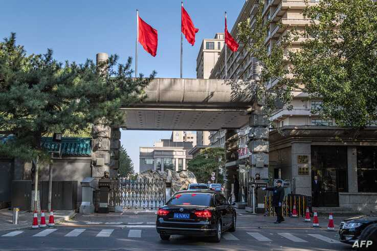 Chinese soldiers and security personnel secure the main entrance of the Jingxi Hotel, site of the Fourth Plenum of China's Communist Party Central Committee, in Beijing, Oct. 28, 2019.