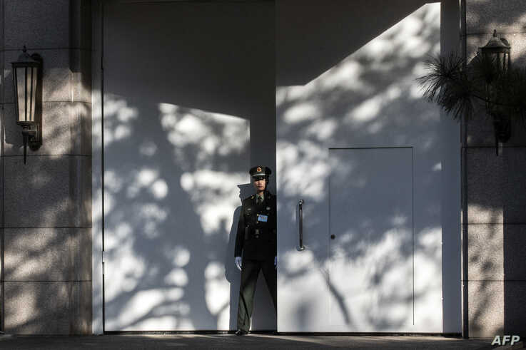 A Chinese paramilitary soldier secures an entrance at the Jingxi Hotel in Beijing, Oct. 28, 2019.