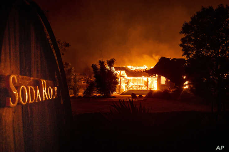 Flames from the Kincade Fire consume Soda Rock Winery, Oct 27, 2019, in Healdsburg, California.