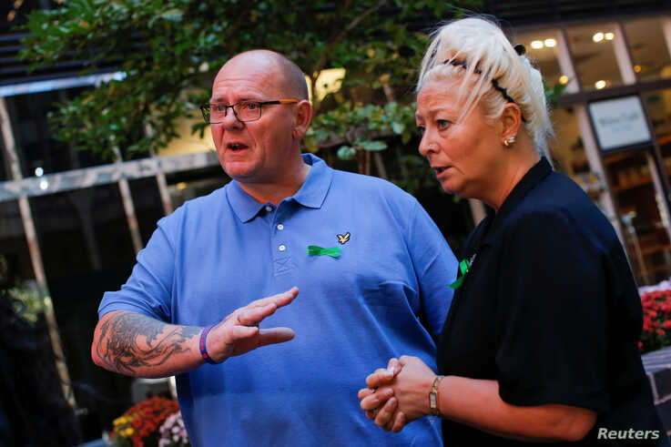 Charlotte Charles and Tim Dunn, parents of British teen Harry Dunn, who was killed on his motorcycle in a collision with a car allegedly driven by the wife of an American diplomat, speak during a interview in Manhattan, New York City, Oct. 15, 2019.