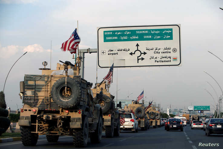 A convoy of U.S. vehicles is seen after withdrawing from northern Syria, in Erbil, Iraq