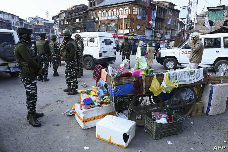 Soldiers secure an area after a grenade blast at a market in Srinagar on November 4, 2019. - At least one person was killed and…