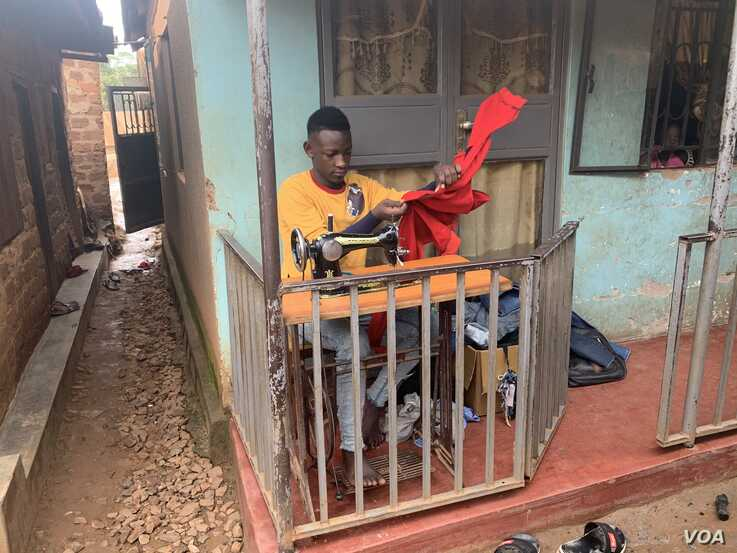 11-25-19 Photo by Halima Athumani. Kabogoza Timothy, the 1st runner up in the 20192020 Y+ Beauty Pageant, operating a sewing machine infront of their home in Bwyogerere, a Kampala slum.