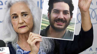Debra Tice, mother of US journalist Austin Tice who was kidnapped in Syria five years prior, holds a dated portrait of him…