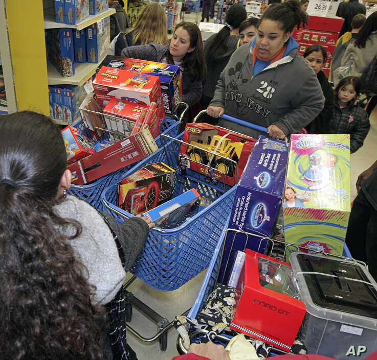 File -- A traffic jam of Black Friday shoppers in the aisles of a toy store in San Rafael, California.