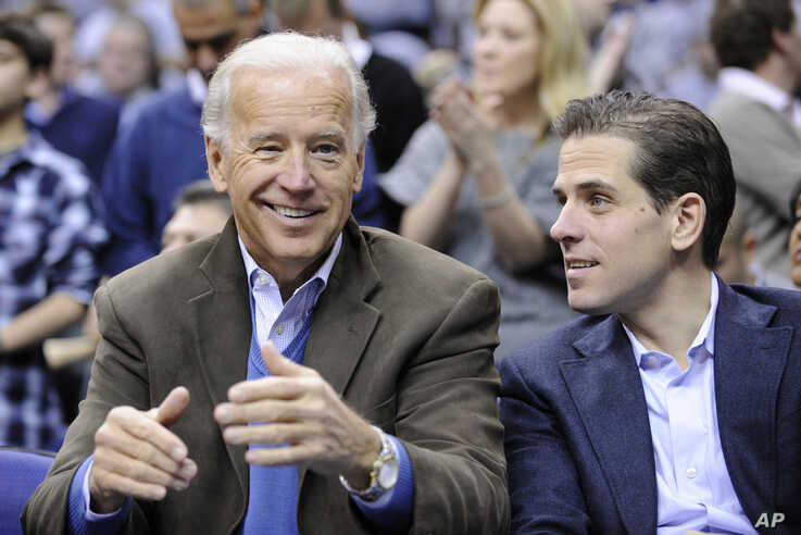 FILE - In this Jan. 30, 2010, file photo, Vice President Joe Biden, left, with his son Hunter, right, at the Duke Georgetown…