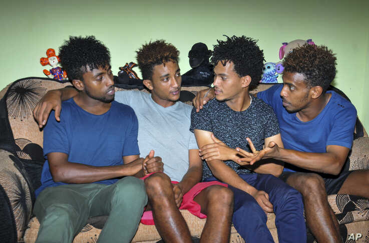 Eritrean under-20 soccer players Hermon Fessehaye Yohannes, Simon Asmelash Mekonen, Hanibal Girmay Tekle, and Mewael Tesfai Yosief talk together in a house where they are staying in Uganda.
