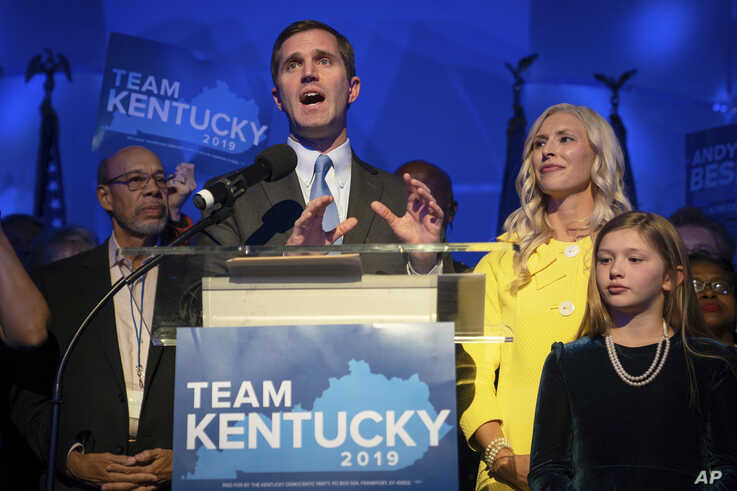 Kentucky Attorney General and democratic Gubernatorial Candidate Andy Beshear stands with his wife, Britainy as he delivers a…