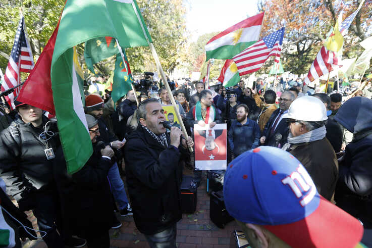 Protesters rally against the Washington visit of Turkish President Recep Tayyip Erdogan outside the White House, Wednesday, Nov…