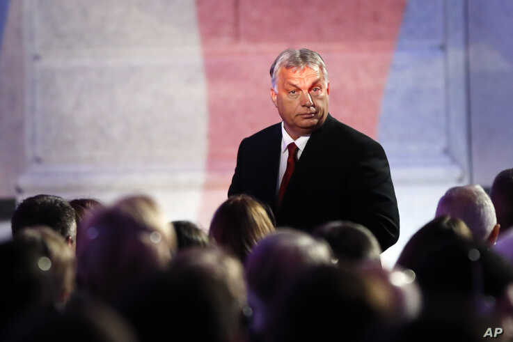 Hungarian Prime Minister Viktor Orban walks after delivering a speech at the National Museum in Prague, Czech Republic, Sunday,…