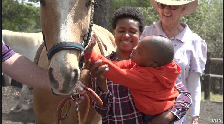"""""""Healing with Horses Therapeutic Centre"""" in Harare (November 21, 2019) a charity is supported by donations from companies and individuals with a mission to help heal children and communities (Columbus Mavhunga/VOA)"""