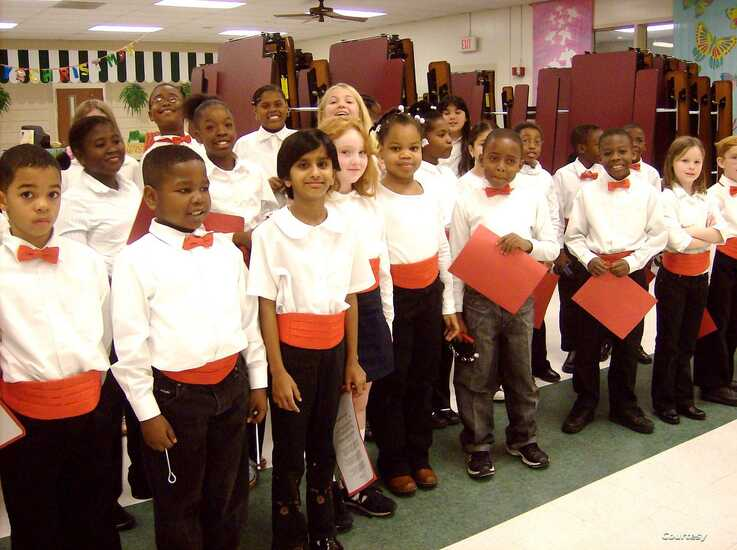 Dolica Gopisetty, 8 years old, front row, participates in a 3rd-grade Christmas choir performance at Brennen Elementary School, Columbia, South Carolina, December 2006. (Photo courtesy of the Gopisetty family)