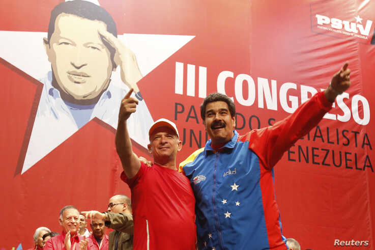 Venezuela's President Nicolas Maduro (R) embraces retired General Hugo Carvajal as they attend the Socialist party congress in…