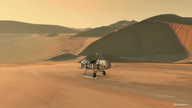 NASA's planned Dragonfly rotorcraft lander approaches a site to explore on Saturn's moon, Titan, in an Illustration released…