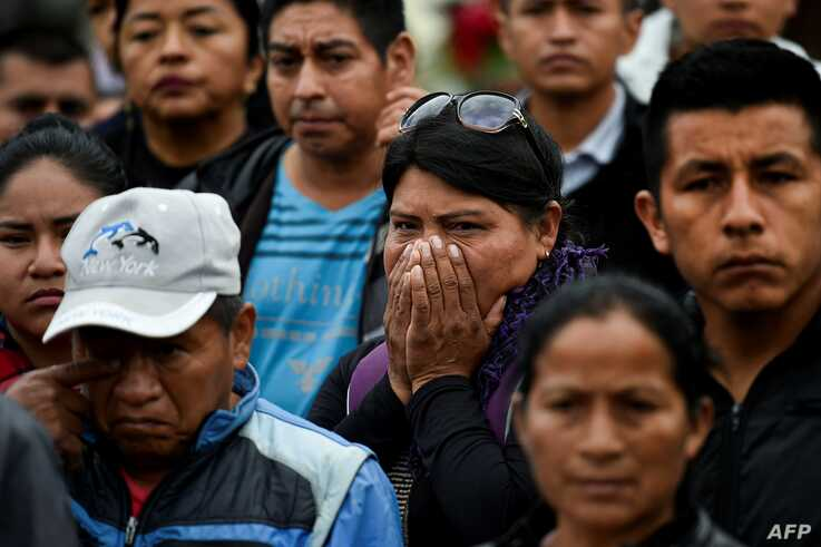 Indigenous people attend the funeral of the five indigenous guards killed during an attack by suspected rebels in Tacueyo, rural area of Toribio, department of Cauca, Colombia, Oct. 31, 2019.