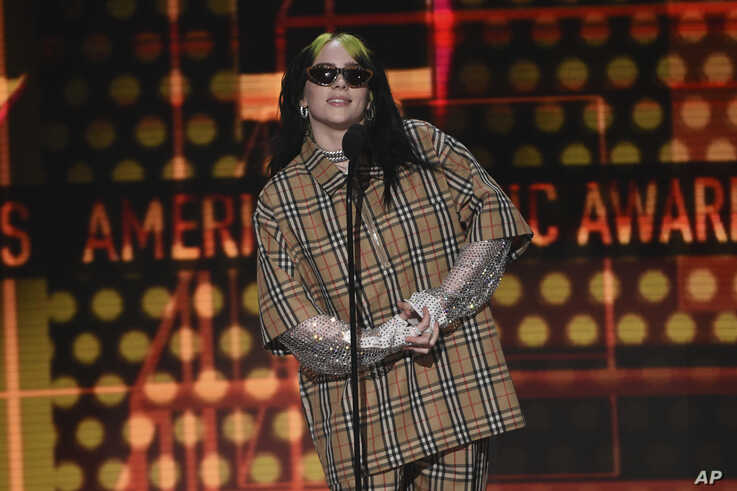 Billie Eilish introduces a performance by Green Day at the American Music Awards, at the Microsoft Theater in Los Angeles, California, Nov. 24, 2019.