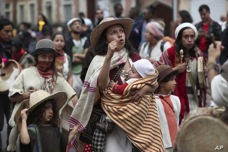 A woman marches with her children in an anti-government demonstration in Bogota, Colombia.