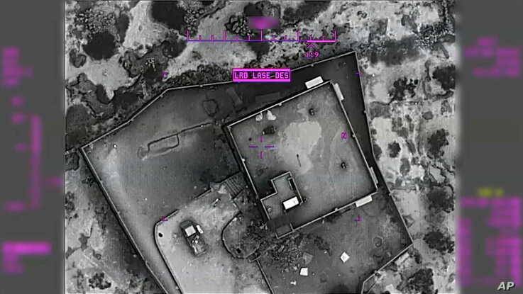 This image from video released by the U.S. Department of Defense Oct. 30, 2019, and displayed at a Pentagon briefing, shows an image of the compound of then-Islamic State leader Abu Bakr al-Baghdadi moments before it was destroyed Oct. 26, 2019.