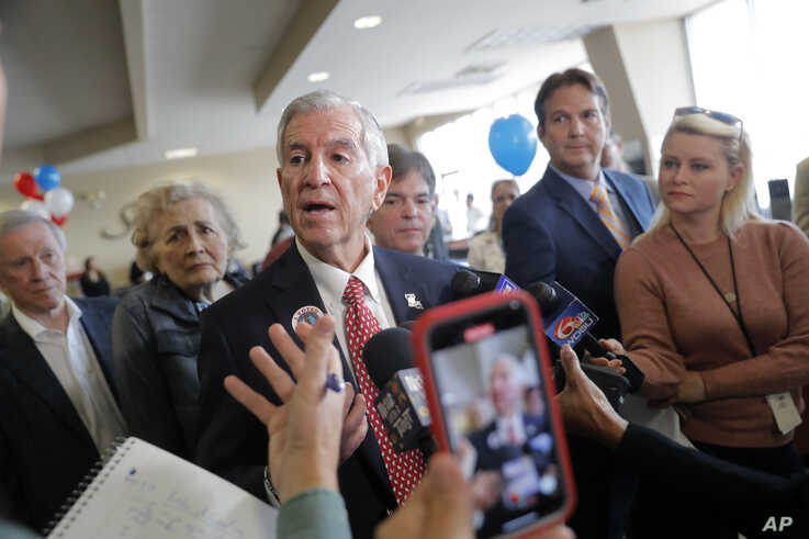 Louisiana's Republican gubernatorial candidate Eddie Rispone talks to media on a campaign stop at New Orleans International Airport in Kenner, La., Nov. 4, 2019.
