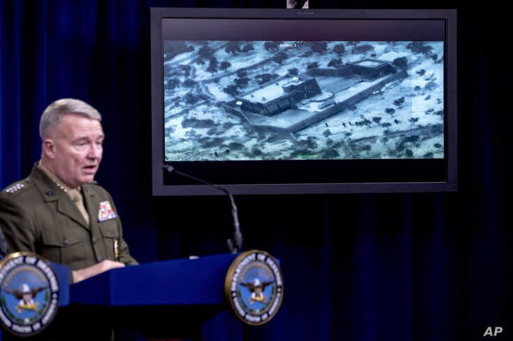 Video of the Abu Bakr al-Baghdadi raid is displayed as U.S. Central Command Commander Marine Gen. Kenneth McKenzie speaks, Oct. 30, 2019, at a joint press briefing at the Pentagon in Washington.