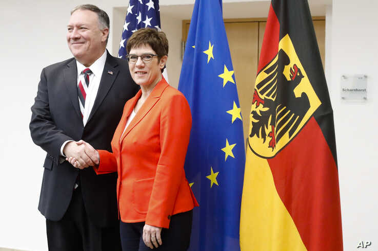 German Defense Minister Annegret Kramp-Karrenbauer, right, shakes hands with U.S. Secretary of State Mike Pompeo, prior to a meeting at the Defense Ministry in Berlin, Germany, Nov. 8, 2019.
