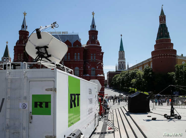 FILE - Vehicles of Russian state-controlled broadcaster RT are seen near the Red Square in Moscow, Russia, June 15, 2018.