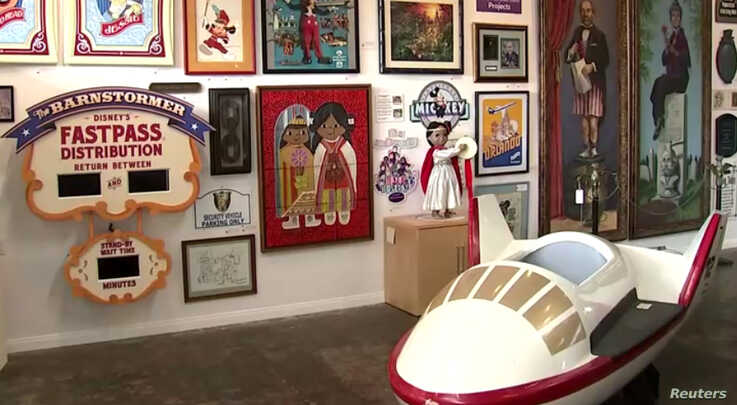 Rare items on display from Disneyland and Walt Disney World that will go on auction at the Van Eaton Galleries, in Los Angeles. Among them are