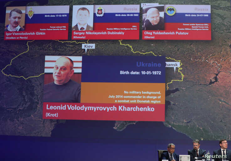 FILE - Russian nationals Igor Girkin, Sergey Dubinskiy, Oleg Pulatov, and Ukrainian Leonid Kharchenko, accused of downing of MH17, are shown on screen as international investigators present their latest findings, in Nieuwegein, Netherlands, June 19, 2019.