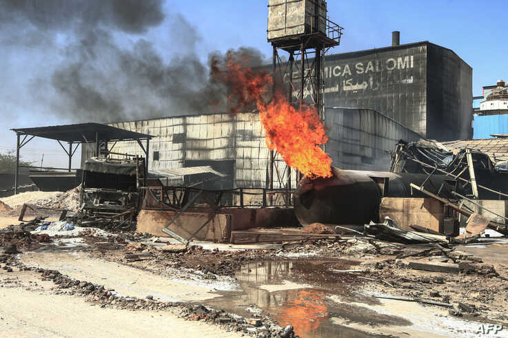 This picture taken on December 3, 2019 shows a burning gas tank at the scene of a fire at a tile manufacturing unit in an…