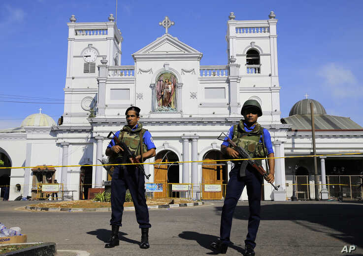 Sri Lankan Navy soldiers stand guard in front of the St. Anthony's Shrine a day after the series of blasts, in Colombo, Sri Lanka, April 22, 2019.