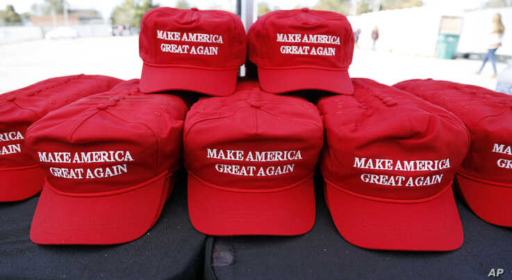 """""""Make America Great Again"""" hats available for purchase outside an arena in Tupelo, Miss., Nov. 1, 2019, ahead of a Keep America Great rally."""