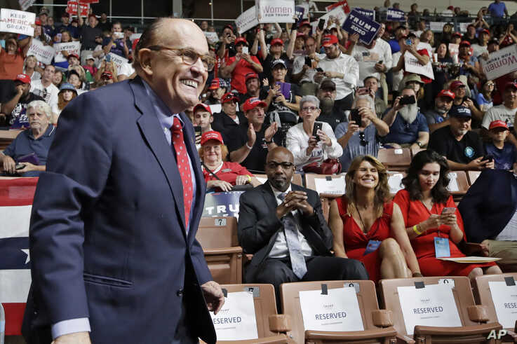 FILE - Former New York City Mayor Rudy Giuliani at a Trump rally in New Hampshire.