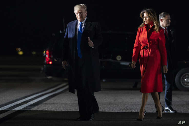 President Donald and first lady Melania Trump arrive at London Stansted Airport to attend the NATO summit, Dec. 2, 2019.