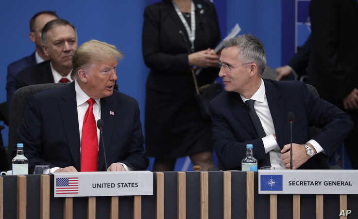 U.S. President Donald Trump and NATO Secretary General Jens Stoltenberg participate in a round table meeting during a NATO…