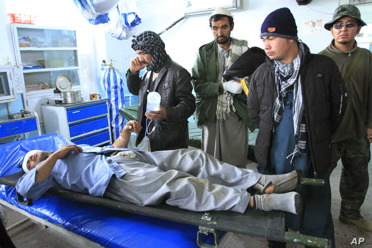 An Afghan man wounded in a roadside blast is treated at a local hospital in the city of Ghazni, west of Kabul, Afghanistan.